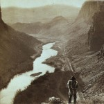 A Native American overlooking the newly completed transcontinental railroad in 1868.