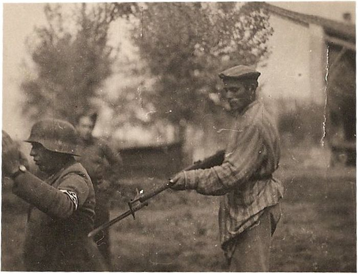 A liberated Jew holds a Nazi at gunpoint