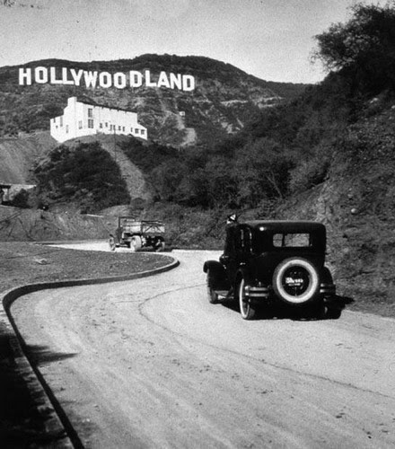 The Hollywood sign was still the 'Hollywoodland' sign. The last four letters were removed in 1949.